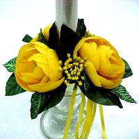 1 Ranunculus candle ring with ribbon bow.